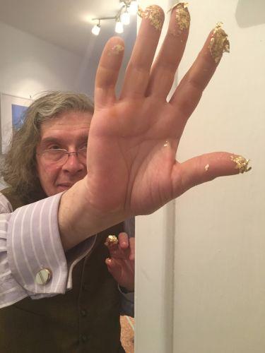 Mani d'oro